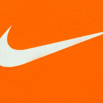 White Nike Logo on Orange Background;Nike, Inc. is an