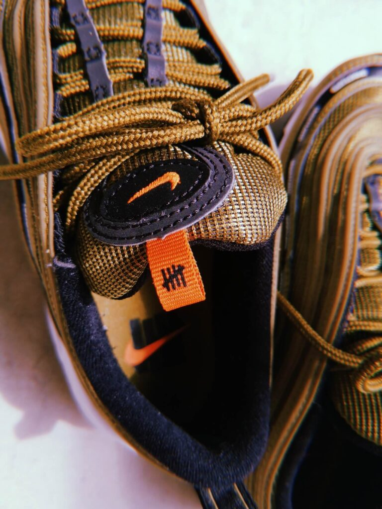 Undefeated x AM97_SNKRGIRL_logo