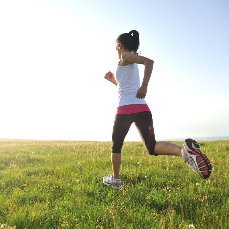 running_woman_on the grass field